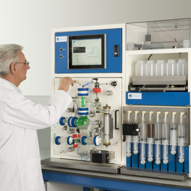 A frontal view of a lab technician using the tiny-TIM by Triskelion