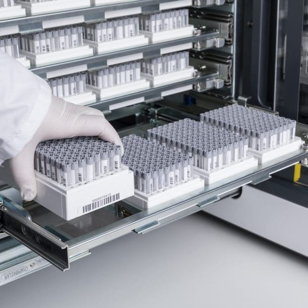 HT700 in action with open tray and racks of Micronic hybrid tubes